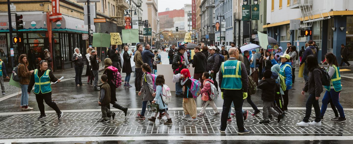 A group of people protest outside in the Tenderloin streets