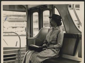 Black and white photo of Rosa Parks on a bus